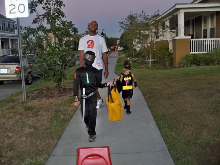Me and my two kids enjoying trick-or-treating by being visible, predictable, and aware